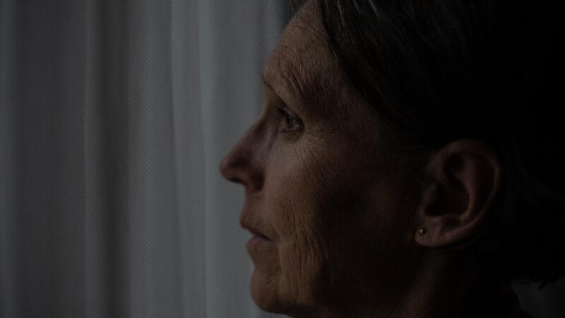 A woman looks outside